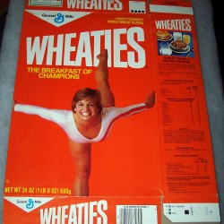 1986 Mary Lou Retton (balancing with back leg in air) (free poster offer on back)
