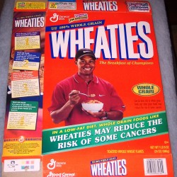 1999 Tiger Woods (eating cereal) (green banner on front)
