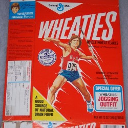 1977 Bruce Jenner (throwing javalin) (jogging outfit offer on front)