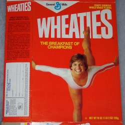 1984 Mary Lou Retton (balancing with back leg in air) (free poster offer on back)